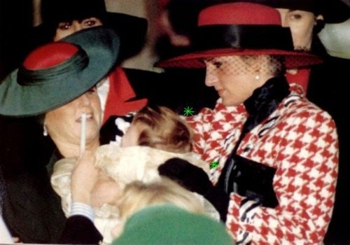 Diana giving Sarah a hand with Princess Eugenie after the infant's December 1990 christening