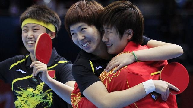 China's Guo Yue (L-R), Li Xiaoxia and Ding Ning celebrate after defeating Japan in their women's team gold medal table tennis match at the ExCel venue during the London 2012 Olympic Games August 7, 2012