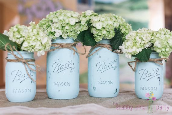 Charming hand painted and distressed classic Ball Mason Jars. Let these mason jars become your one-of-a-kind accent piece at your upcoming