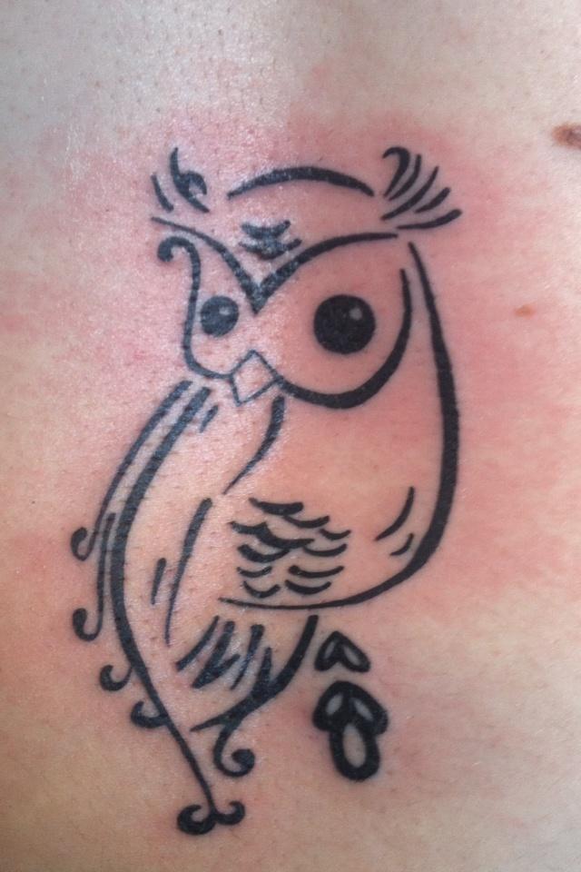Owl tattoo... kind of looks like its pooping