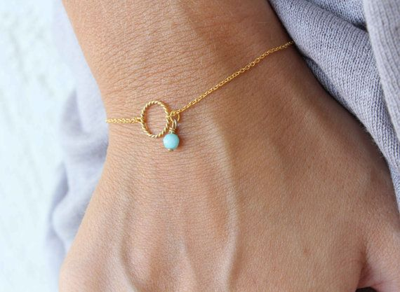 Karma Bracelet - Circle of life chain Bracelet - Eternity bracelet - Minimalist bracelet - Everyday Bracelet - Bridesmaids gift - Wedding Jewellery  You can wear this bracelet alone or stack it with others!!!So cute and simple!  This delicate and dainty bracelet is made with:  ♥ Gold plated twisted circle of life charm, measures 10mm ♥ A beautiful jade stone pendant in light blue or you can select my other colours!  ♥ Delicate gold plated chain. You can choose your preferred length above or…