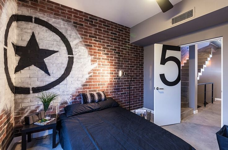 Industrial bedroom with brick walls, concrete floors, and graffiti art - Graffiti in interior design