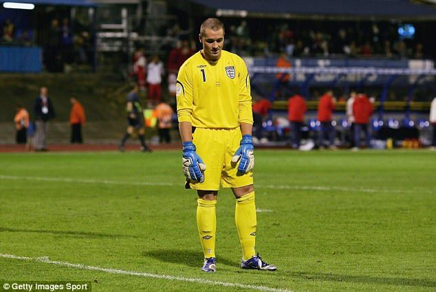 Paul Robinson cuts a dejected figure after Gary Nevile's back-pass bobbled over his foot