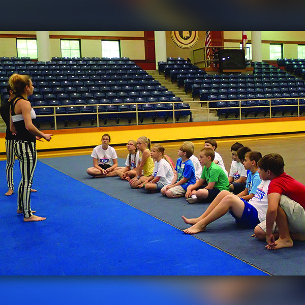 Sara instructing a group of kids on proper gymnastic body position.  #LearnCircus #TheImperialOPA #Circus #Atlanta #OPA #AtlantaCircus ------------- #1 rated entertainment booking company in GA!   Contact us today and lets make unforgettable events together!