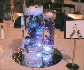blue orchid bouquets   These blue and purple orchid centerpieces were for an indoor reception ...