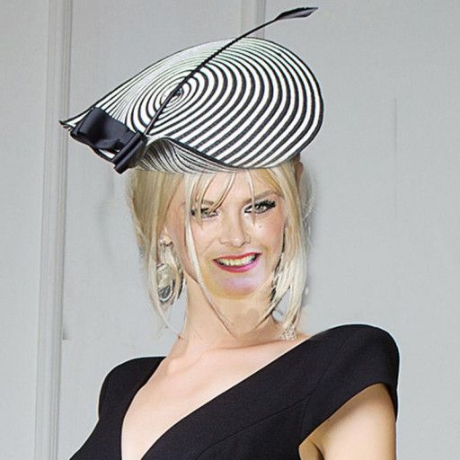 "Elegant and classy, this beautiful black and white fascinator hat is sure to turn heads!   Top your evening wear with this unique striped fascinator hat. Elegant to wear at a wedding, cocktail, party or just an evening out in the town.  It measures approx. 12"" and it features grosgrain ribbon bow and a feather.  A really stylish fascinator!   Please contact me for International shipping rates."