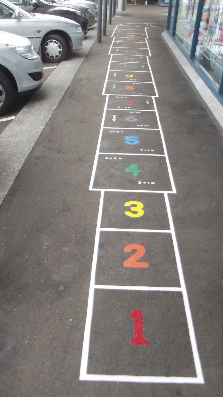 "Hop Scotch painted on foot path, upstairs, ""Capital Gateway Centre"", Thorndon Quay, Wellington."