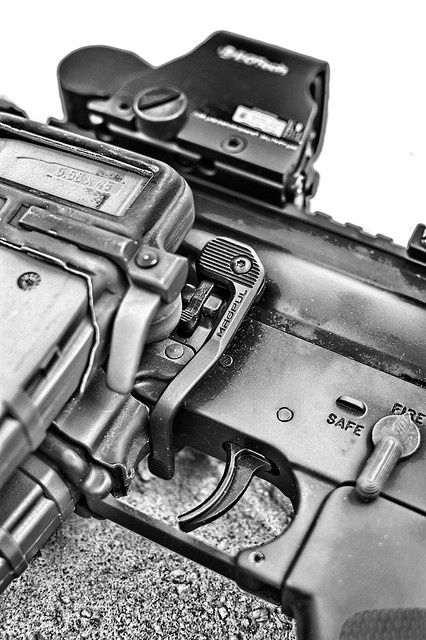 B.A.D. lever by Magpul - designed to quickly address reloading and malfunction clearance shortcomings of AR15/M16 platforms by extending a paddle to the right side of the weapon, allowing manipulation of the bolt stop from the fire control/ready position with the right-hand trigger finger.