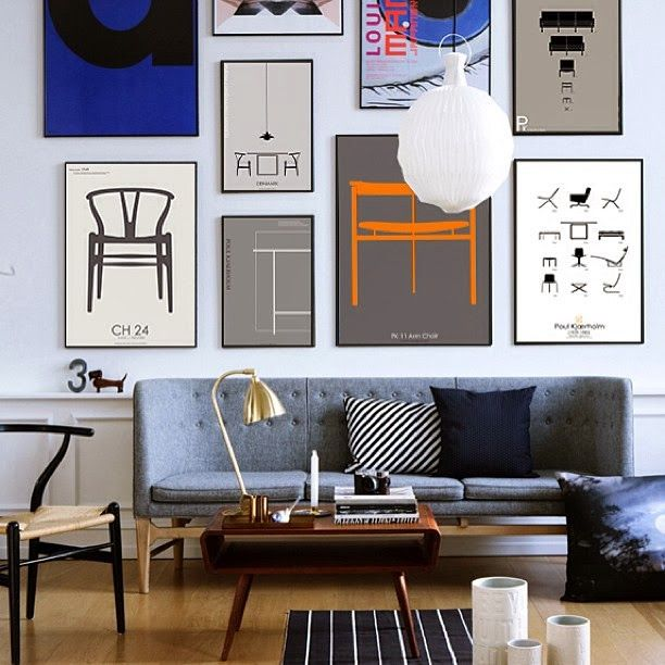 Custom frames on modern prints, grouped on a wall over a sofa for impact.