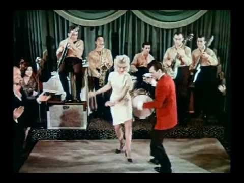 """""""The Twist"""" by Chubby Checker - an all-time wedding dance song classic - lots of exercising going on in this song"""