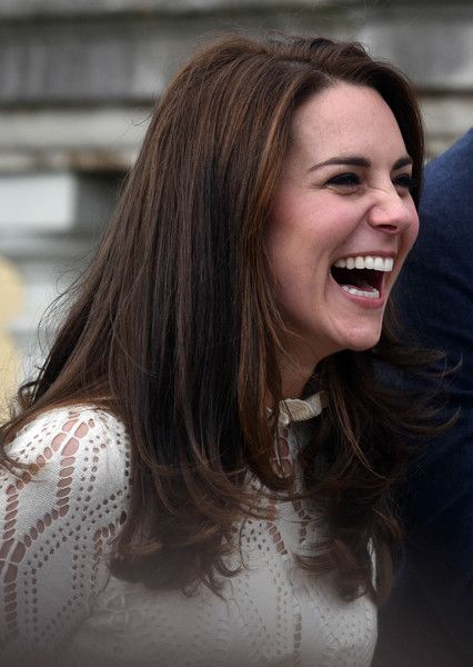 Catherine, Duchess of Cambridge laughs as they host a tea party in the grounds of Buckingham Palace to honour the children of those who have died serving in the armed forces on May 13, 2017 in London.