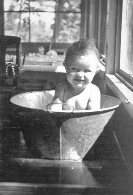 Baby in a metal tub: 1950