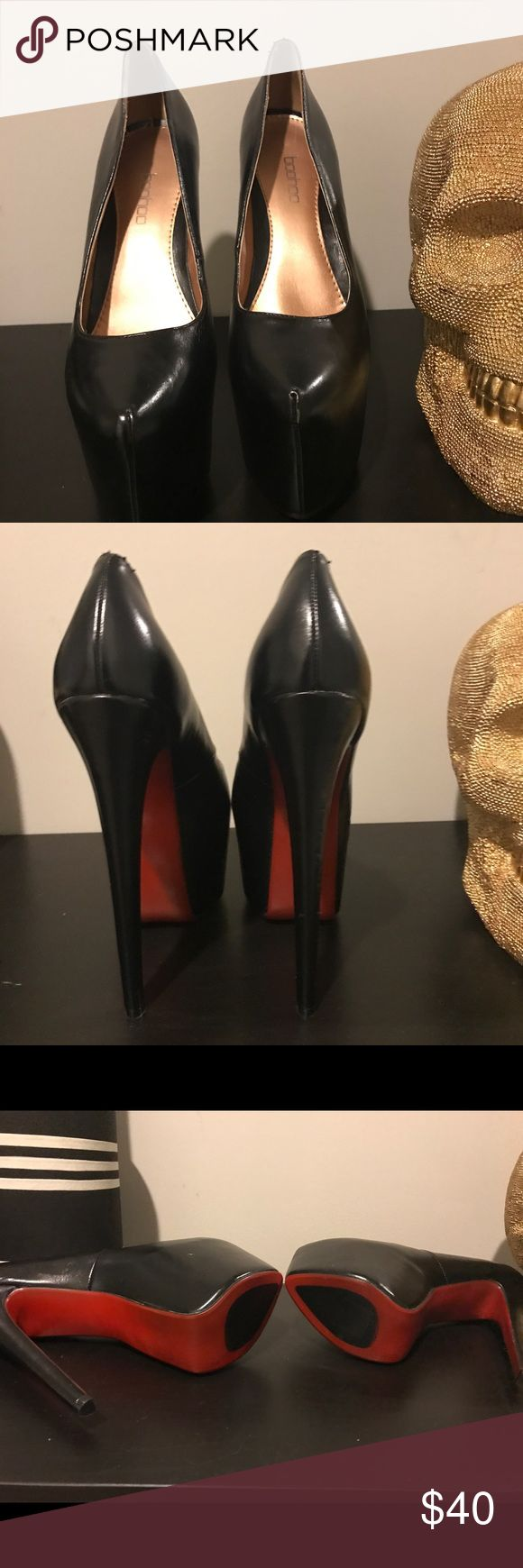 Black Platform heel with red bottom 7 inch heel with 3 inch platform. This shoe has never been worn before. The box read size 10 but definitely fit like a solid 9! I no longer have the box, but shoes are in perfect condition. NWOT Boohoo Shoes Heels