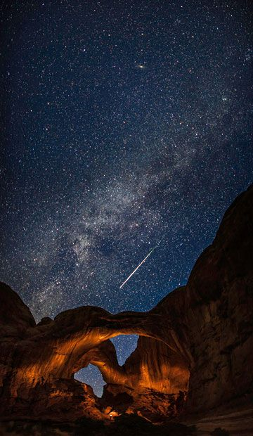 Double Arch with a Perseid Meteor and the Milky Way by Thomas O'Brien (USA). A meteor is captured streaking across the sky above Arches National Park, Utah, during the annual Perseid meteor shower.