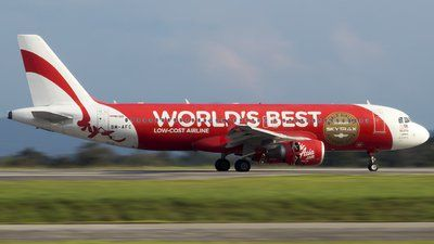 AirAsia (MY) Airbus A310-214 9M-AFC aircraft, painted in ''World's Best Low Cost Airline'' special colours 2010, with the sticker ''World Airline Winner Skytrax Awards 2009'' on the airframe, skating at Malaysia Kuching International Airport. 13/03/2017.