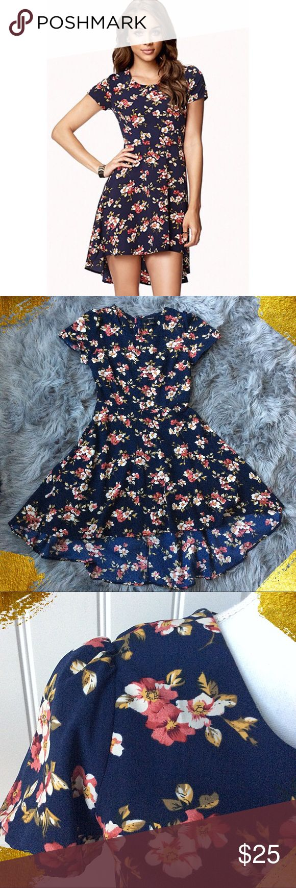 Adorable Floral High Low Dress Adorable navy high low dress with vintage floral print.  Gathered capped sleeves.  Hidden back zipper.  Pretty pleated detailing in the back.  High low hemline.  In fantastic condition! Forever 21 Dresses