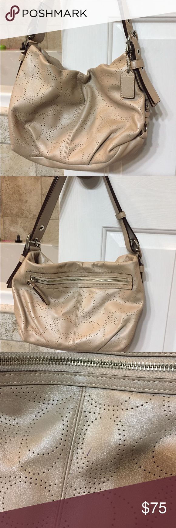 """Coach hobo bag Beautiful leather Coach hobo in excellent condition with the exception of one small pen mark that I haven't tried to remove- see close up pic for details. Tan in color with a shimmery, almost metallic hue.  Approximately 12""""Lx7""""Hx2""""W.  18""""L with handle, with adjustable strap. Coach Bags Hobos"""