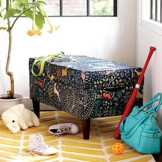 The Land of Nod's As You Wish Upholstered Storage Bench blends the line between fashion and function. This roomy bench can be customized in an array of fabrics, colors and patterns. Its simple, yet versatile design makes it perfect for use as a toy box, bench or seat.