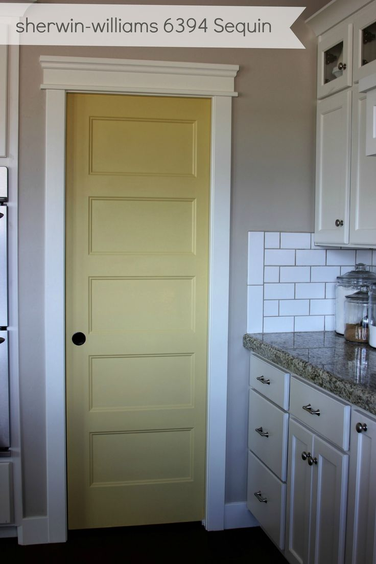 Look at the trim detail added above the door frame (dress up plain trim) - yellow pantry door : SW 6394 Sequin