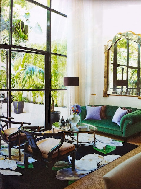 "Great space. ""Singapore Colonial mixed with Manhattan Glamour"". Living room at Ben David's Sydney appartment. Emerald green sofa from George Smith, LA and floral rug from The Rug Company"