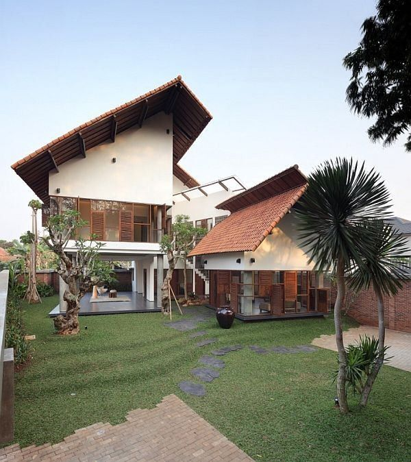 The lovely Distort House was designed by TWS & Partners with principal in charge Tonny W Suriadjaja and structural engineers Purwa, and is located south of Jakarta, Indonesia. Fund on Homedit, this home is an impressive display of taste and warmth.