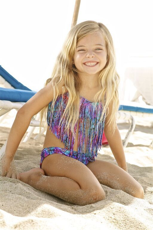The Peixoto Magnolia bikini set features a colorful snake print and designer fringe. The use of this snake print on a fringe top makes it an extra fun bikini for an extra fun girl.  #mommyandme