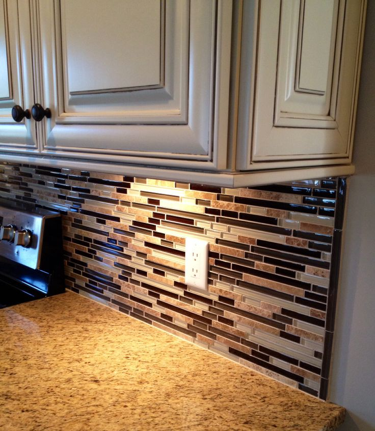 Kitchen With Glass Counter Grey Tile And Maple Cabinets: Mosaic Tile Backsplash With Glass/stone Matched With