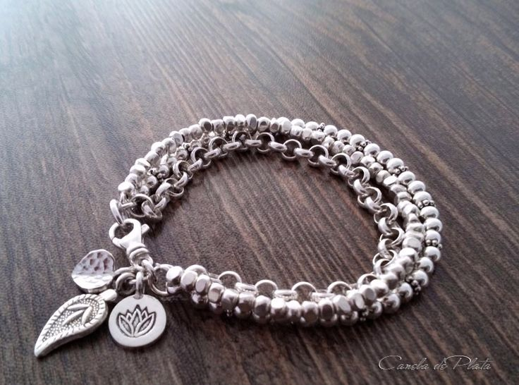 Three strand hill tribe silver bracelet and charms