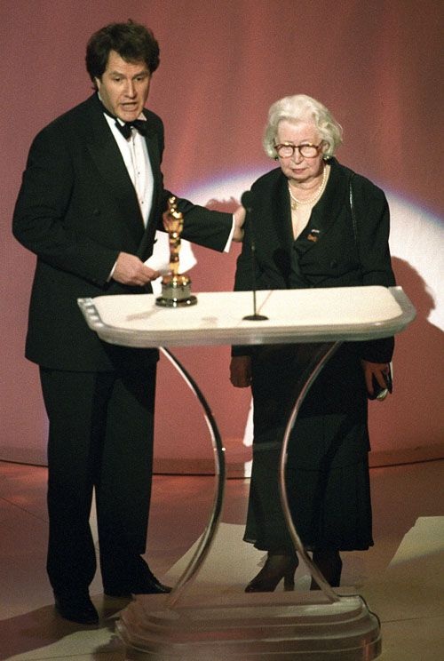 Filmmaker Jon Blair brought Miep Gies, the Dutch woman who helped hide Anne Frank's family and the subject of his documentary Anne Frank Remembered, to the Oscar stage to collect his Best Documentary award in 1996.  (Academy Awards)