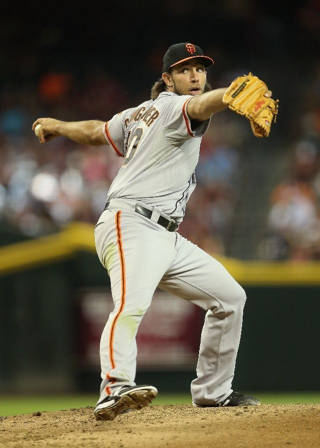 PHOENIX, AZ - JUNE 22: Starting pitcher Madison Bumgarner #40 of the San Francisco Giants pitches against the Arizona Diamondbacks during the MLB game at Chase Field on June 22, 2014 in Phoenix, Arizona. (Photo by Christian Petersen/Getty Images)