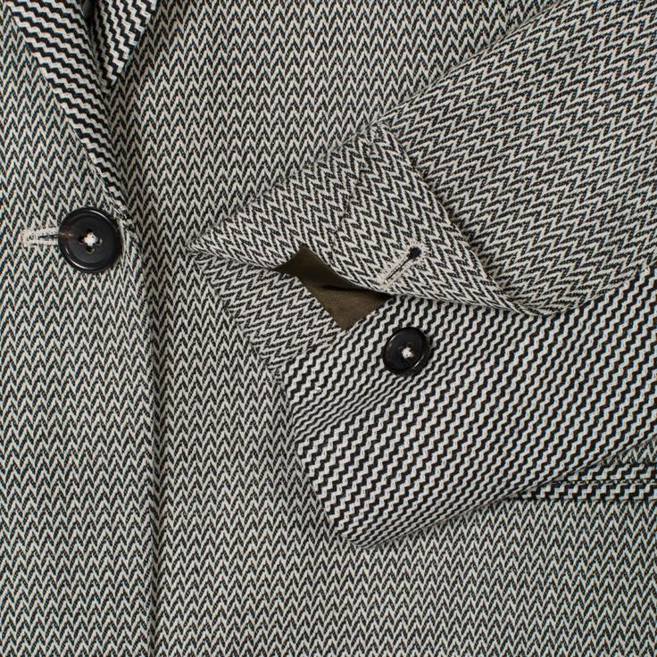 Made from a smooth wool-blend cloth with slight stretch, this black single-vent blazer features an all-over black and light grey mixed chevron jacquard.
