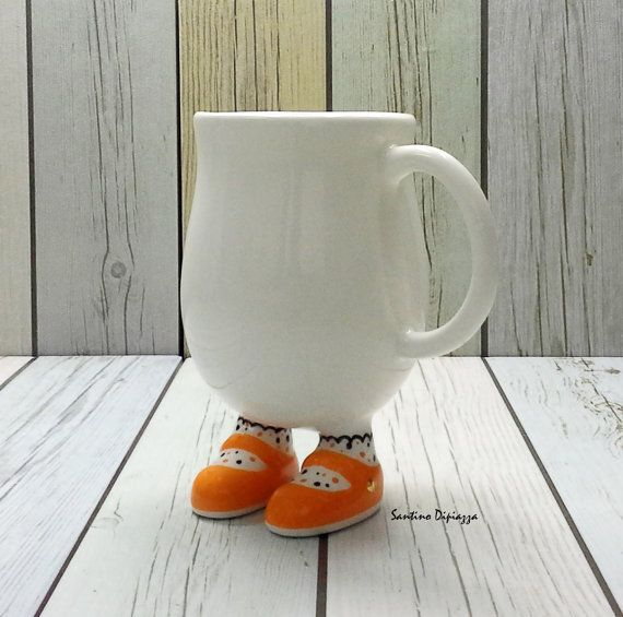 Hand made Mug, Orange Coffee Cup, White Footed Pottery, Funny Coffee Gift, Whimsical Cup, Cute tea Cup, Hand Painted Mug, Shoe Lovers Gift  I love to make Unique Coffee cups all my Walking Pottery is authentically handmade and hand painted by myself, This original collectable is a joy to own and like all of my Walking Pottery it has been made to be used. Size > Height = 5 .5 inches / 13.97 cm Width to outer handle = 4 .5 inches / 11.43 cm Capacity - Holds 13 Fluid ounces / 400ml Dishwasher…