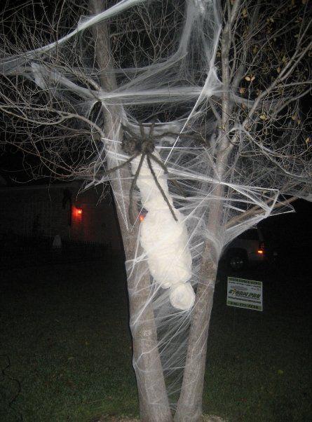 Hahaha, love it!!   {Newspaper + cheese cloth + fishing line + artificial webbing + giant spider #halloween #decor #diy}