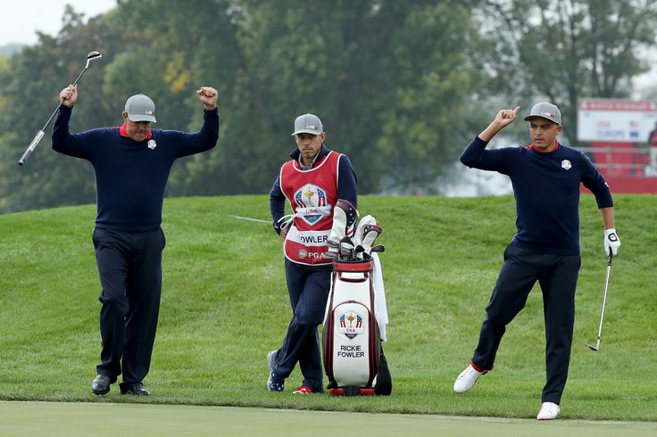 Rickie Fowler Photos Photos - Rickie Fowler of the United States reacts after chipping in on the ninth hole with Phil Mickelson during morning foursome matches of the 2016 Ryder Cup at Hazeltine National Golf Club on September 30, 2016 in Chaska, Minnesota. - 2016 Ryder Cup - Morning Foursome Matches