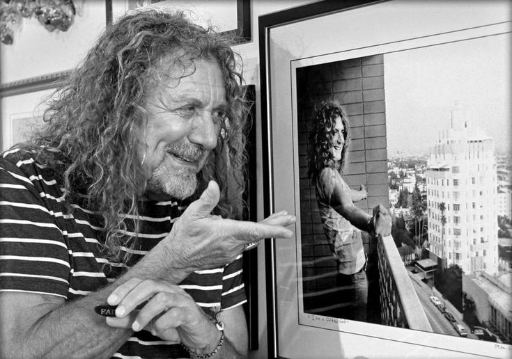 Visiting Peter Simon's gallery on Martha's Vineyard over Labor Day 2017, Robert Plant checks out a picture Simon took of him in 1975.