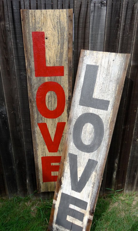 Reclaimed Wood Huge 'Love' Sign, aged wood from the early 1900s, charcoal grey lettering on antique white and yellow wood. $185.00, via Etsy.