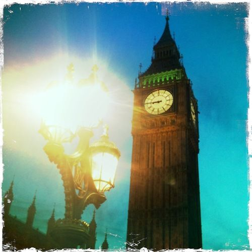 Shot from Big Ben with the sun right through the lamp post