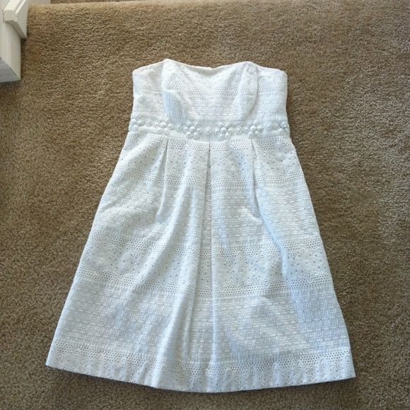 Lilly Pulitzer white dress sz 2 Amazing white eyelet dress with beaded detail. Perfect condition. Pics don't do this beauty justice !! Lilly Pulitzer Dresses