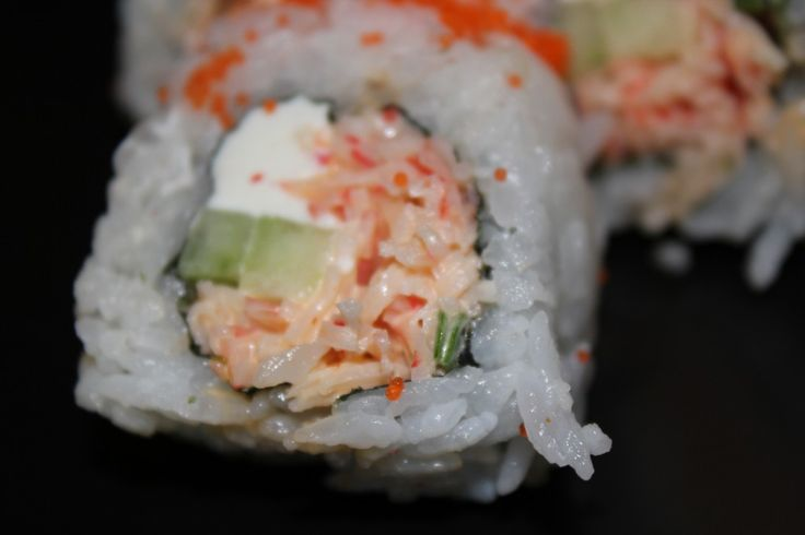 Spicy Crab Sushi Roll Recipe  My Sushi Daddy Spicy Crab Cream Cheese and Cucumber Sushi Roll with Masago     This is one of the easiest American style Sushi rolls to make but it's one of my favorites.  The spicy crab mixture has a nice flavor with a...