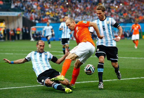 Pablo Zabaleta of Argentina challenges Arjen Robben of the Netherlands.