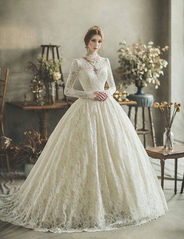 We Re Obsessed With This Vintage Inspired Wedding Gown From Clara Wedding Featuring Elegant Long Sleeves And High Neck With Exquisite Lace Detailing Wedding Dresses Vintage Princess Victorian Wedding Dress Wedding Dresses