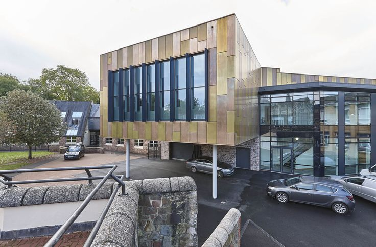 Brass and bronze clad Performing Arts Building at Bristol Grammar School | Education Construction Photographer | Interior Photographer Berkshire