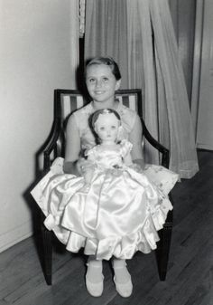 Vintage photo of a young girl with her large Madame Alexander Doll, July 1956.
