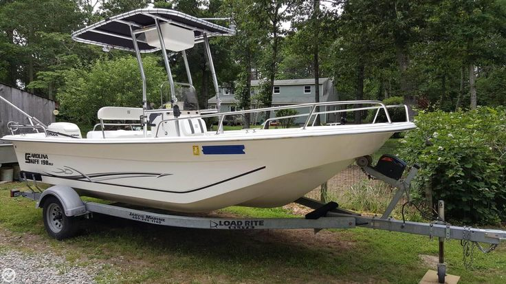 2012 CAROLINA SKIFF 198 DLV INCLUDES EVINRUDE 115 HORSE AND TRAILER READY TO ROCK AND ROLL