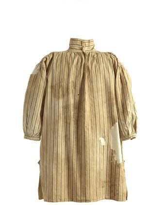 This blue and white stripped Indian cotton shirt was excavated from under the floorboards on level three of the Hyde Park Barracks, apparently near the staircase during restoration in 1980. The shirt is the only known intact example of the most common garment issued to convicts in their thousands.