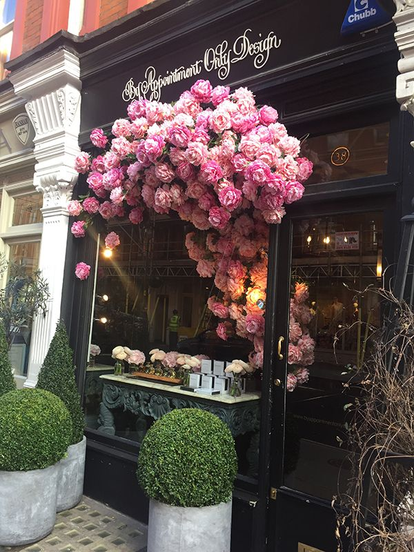 Gorgeous blooming window display by By Appointment Only Design.