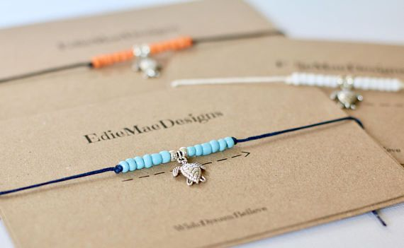 This tie on ankle Bracelet makes a simple yet gorgeous present. It is made from Black waxed cotton cord, Orange glass beads and a Silver turtle charm. They are designed to be tied to your ankle with any excess cord cut off. All bracelets are mounted onto approx a 9x14cm EdieMae recycled Kraft card. Each Anklet comes with a cream envelope so they are ideal to send as a present. --------------------------------------------------------------------------------------------------------- Size: One…