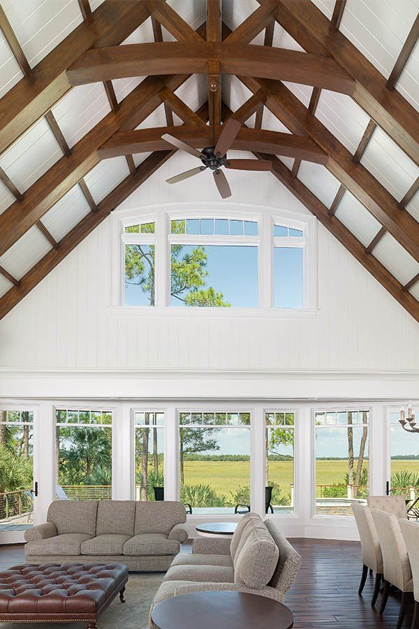 Vaulted Ceilings Give Living Rooms With Big Windows A Lot Of Natural Light Vaulted Ceiling Living Room Open Concept Living Room Big Windows Living Room