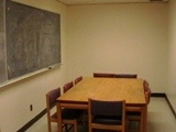 Team Rooms are available on the 4th and 5th floors for group work.  These rooms are outfitted with a conference table and chairs for 6-8 people.  To schedule a room, click the pic and fill out the SU Library Room reservation form.
