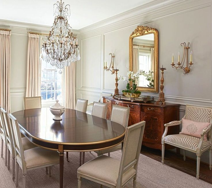 Schumacher fabric brings an elegant touch to the dining room on window treatments and upholstered chairs. The table is from Hickory Chair. Interior design by Lyndsy Woods. Image by Marc Mauldin. See more at www.StyleBlueprint.com.